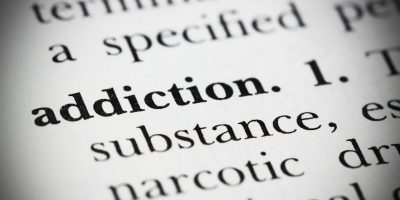 close-up of the word addiction on a dictionary page