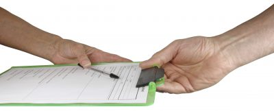 client and counsellor hands exchanging clipboard