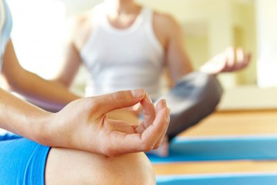 closeup of hands in focussed meditation pose