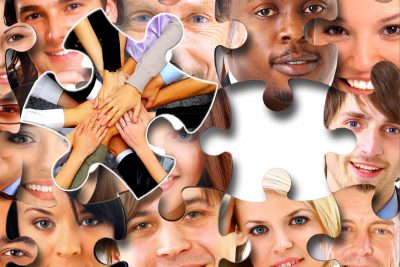 group of diverse people faces on puzzle pieces