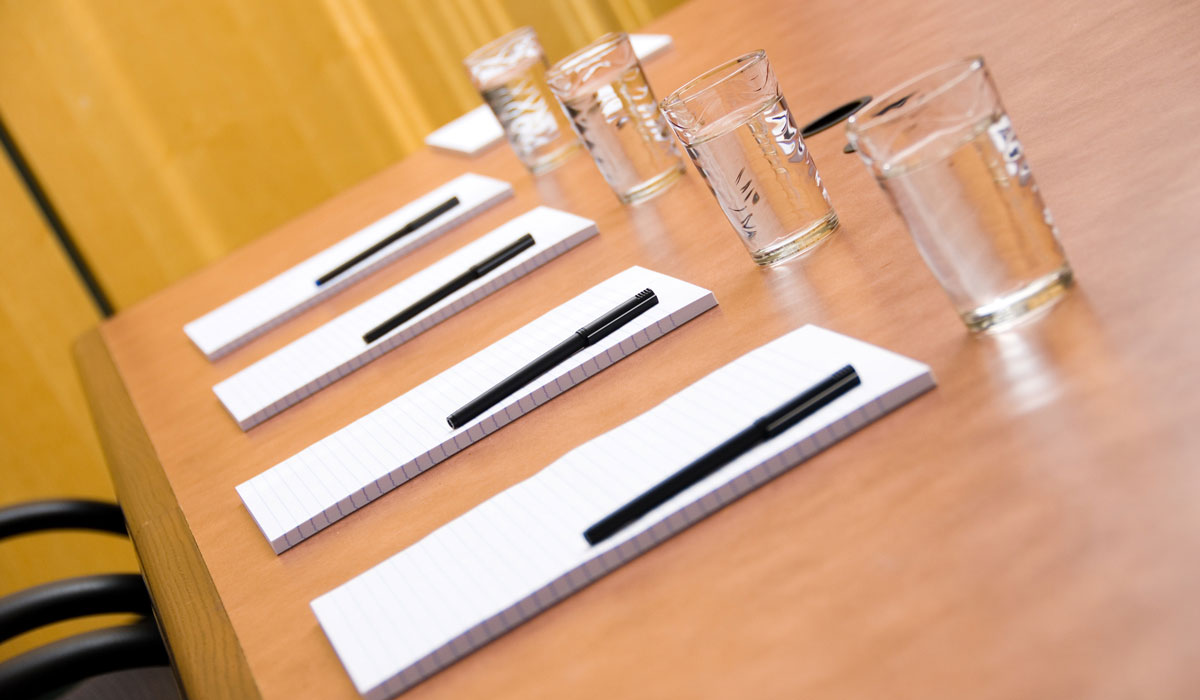 Set boardroom with some water glasses and some paper
