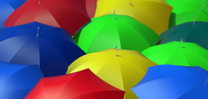 grouping of bright coloured umbrellas