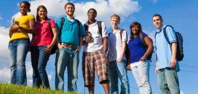 diverse group of youth standing on hill