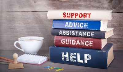 stack of books on support advice guidance and help