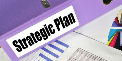 strategic plan binder with charts and graphs