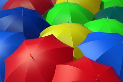 red blue yellow and green umbrellas in a group