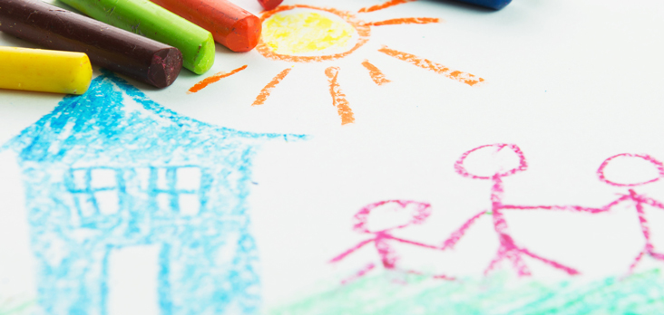 crayons with a child stick drawing of a mother and child beside a house under a bright sun