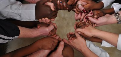 group of hands clasped in unity