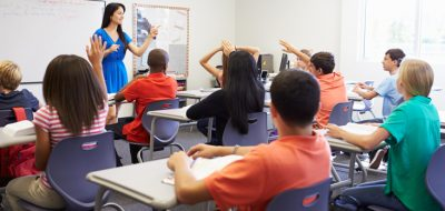counsellor in front of class of students seated at desks