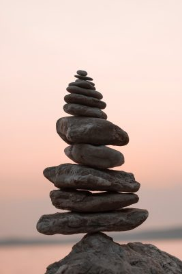 balanced stones against a sunset