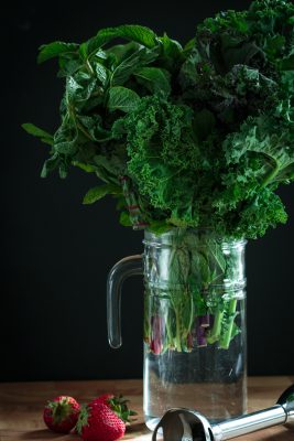 clear mason jar filled with leafy greens