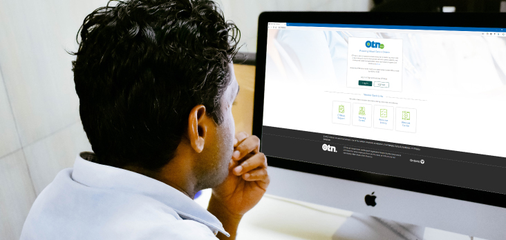 man on computer accessing virtual care portal