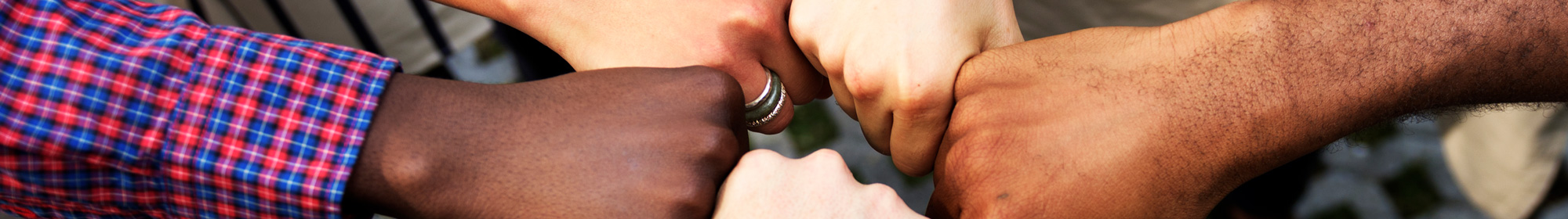 group of diverse counsellors bumping fists