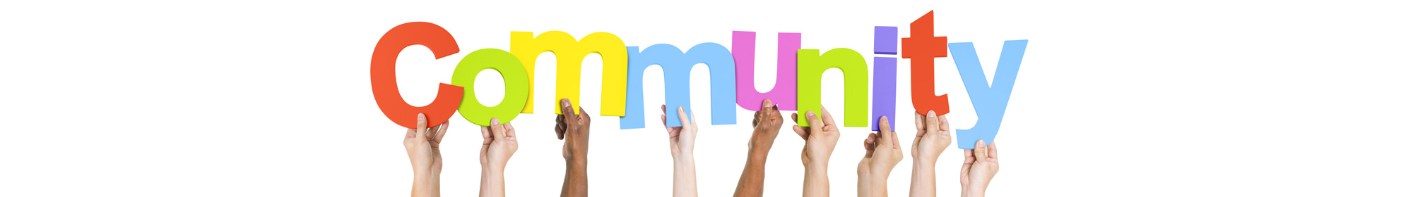 diverse hands holding up colourful letters to spell community