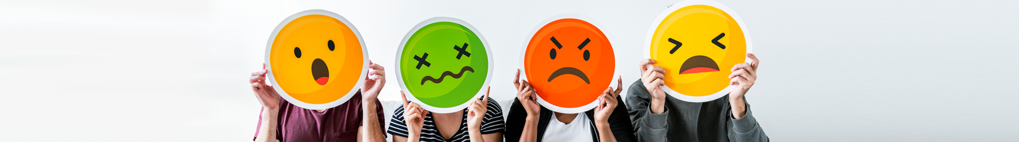 diverse group holding unhappy emoticons in front of their faces