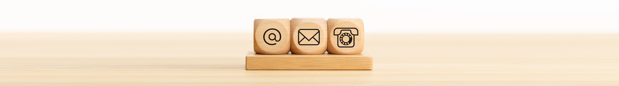 Contact us wooden blocks with email, mail and telephone icons