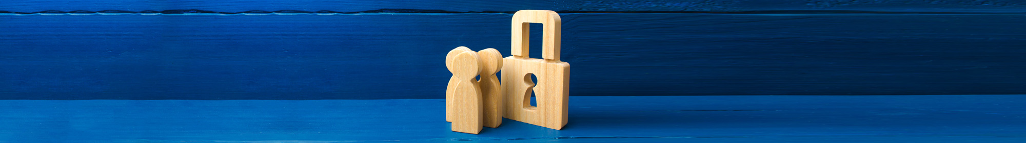 wooden lock with old fashioned keyhole on blue wooden tabletop